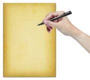 Main avec le crayon lecteur et le vieux papier Photographie stock libre de droits
