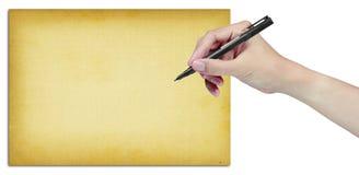 Main avec le crayon lecteur et le vieux papier Photo stock