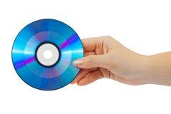 Main avec le disque d'ordinateur Images libres de droits
