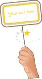 Main avec le drapeau jaune Images libres de droits