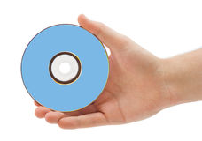 Main avec le dvd Photographie stock