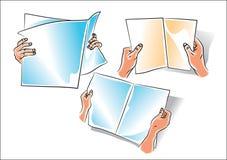 Main avec le journal Photographie stock
