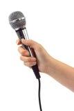 Main avec le microphone image libre de droits