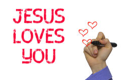 Main avec le mot Jesus Loves You d'écriture de marqueur Photos stock