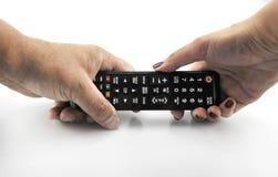 Main avec le pointage à télécommande en avant d'isolement au blanc le 11 septembre 2016 Image libre de droits