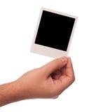 Main avec le polariod Photos stock