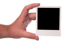 Main avec le polariod Images libres de droits
