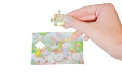 Main avec le puzzle Image stock