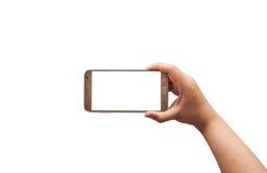Main avec le smartphone d'isolement, chemin de coupure Photographie stock libre de droits