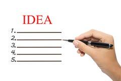 Main avec le stylo et la liste de contrôle d'idée Photo libre de droits