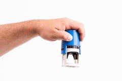 Main avec le timbre Image libre de droits