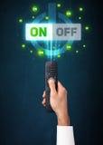 Main avec les signaux à télécommande et marche-arrêt Photos libres de droits