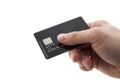 Main avec par la carte de crédit Photo stock
