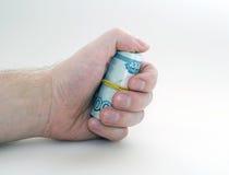 Main avec un paquet d'argent Images libres de droits