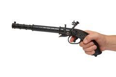 Main avec un vieux pistolet Photographie stock libre de droits