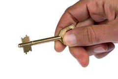 Main avec une clé Photographie stock libre de droits