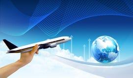 Main, avion et monde Photographie stock