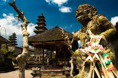 Main Bali temple Pura Besakih. At the foot of the volcano Agung. Balinese sacred mountain Agung colored in pink by sunset light. The must visit religious stock image
