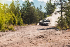 Main battle tank are going to dust on the ground Royalty Free Stock Photography