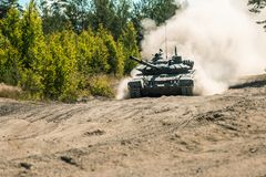 Main battle tank are going to dust on the ground Stock Photo