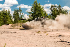 Main Battle Tank Russia are going to dust on a forest road Royalty Free Stock Photography