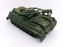 Main battle tank stands in position to shoot. Toy Royalty Free Stock Photo