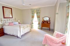 Main bedroom. This very elegant main bedroom of a heritage listed house has the genuine antique style bed and furniture to match Stock Images