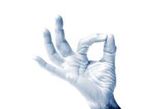 Main bleue d'OK de son Photos stock