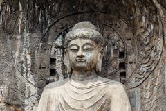 Main Buddha statue in Fengxiangsi Cave, the main one in the Longmen Grottoes in Luoyang, Henan, China. Longmen is one of the 3 major Buddhist caves of China Stock Photography