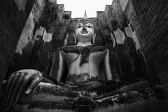 The main Buddha statue in Sukhothai, Thailand, black and white Stock Image