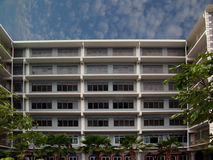 Modern building at private school. Main building of a new private bilingual school near Bangkok, Thailand, under a milky sky Stock Photography