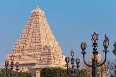 Main building of the Chattarpura temple complex. View of lamps with a traditional Hindu six-pointed star, and the main building of the Chattarpura temple complex Stock Photos
