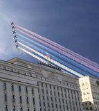 Main Building of the Ministry of Defence of the Russian Federation and Russian military aircrafts fly in formation, Moscow, Russia stock images