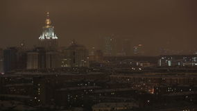 Main building of Moscow State University at night winter in Moscow, Russia, view through window stock video