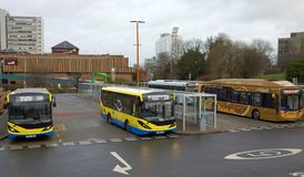 The main Bus Station in Bracknell,England. Bracknell,England - December 30, 2017: Buses wait to pick up passengers at the main Bus Station in Bracknell Town Royalty Free Stock Image