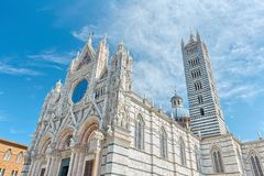 The main cathedral (duomo) in Siena Italy, with its dome and tall striped tower. Stock Images
