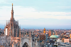 Main cathedral panorama at dusk in Milan Stock Photography