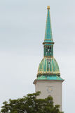 The main cathedral tower in Bratislava with a green roof and a c Stock Images