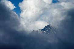 Main Caucasus Range. Mountains peaks in the clouds Royalty Free Stock Photos