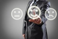 Main choisissant le sourire Image stock