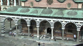 The main church and belfry Rila Monastery in Bulgaria stock footage