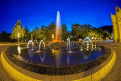 Main colonnade in the small west bohemian spa town Marianske Lazne Marienbad and singing fountain at night - Czech Republic. Main colonnade in the center of stock photos
