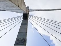 Bridge tower concrete columns with cable stays; Urban city transportation architecture structure, viewed from below. stock photography