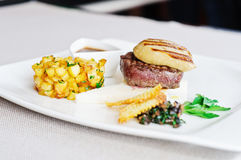 Main course with beef steak and foie gras Stock Photography