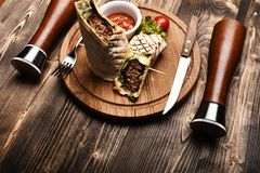 Main course concept. Minced meat wrapped with lavash royalty free stock photography