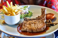 Free Main Course Pork T-bone Steak With Vegetables Salad In White Dish. Royalty Free Stock Images - 164959929