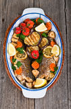 Main course: whole fried seabass served on wood Royalty Free Stock Photo