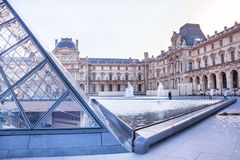 Main courtyard of Louvre Museum with pyramid and fountain. Paris. Royalty Free Stock Photography