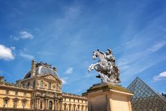 Main courtyard of the palace of the Louvre palace with an equestrian statue of king Louis XIV in Paris France. Main courtyard of the palace of the Louvre palace Stock Photography