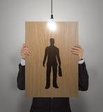 Main d'homme d'affaires avec l'affiche choisissant des personnes Photos stock